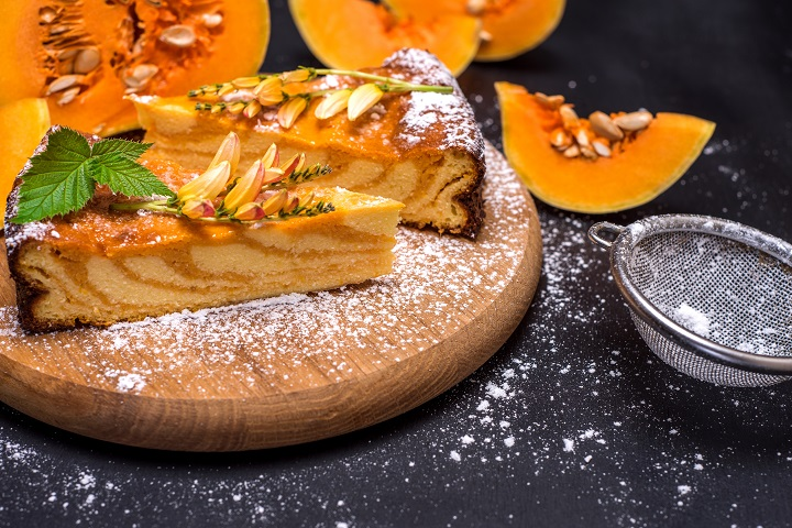 pieces of pumpkin pie on a wooden board, close up