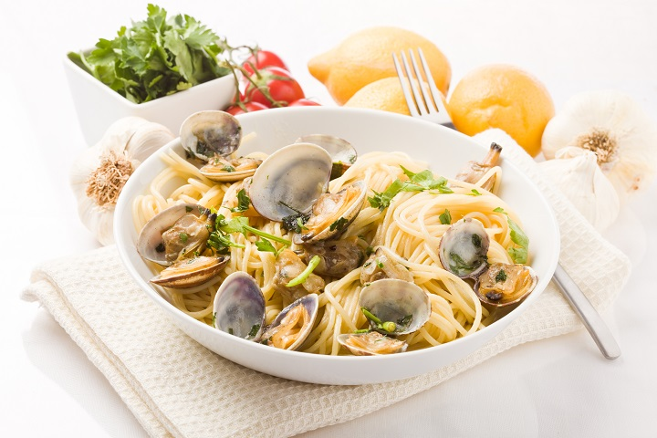phto of delicious pasta with clams on white background
