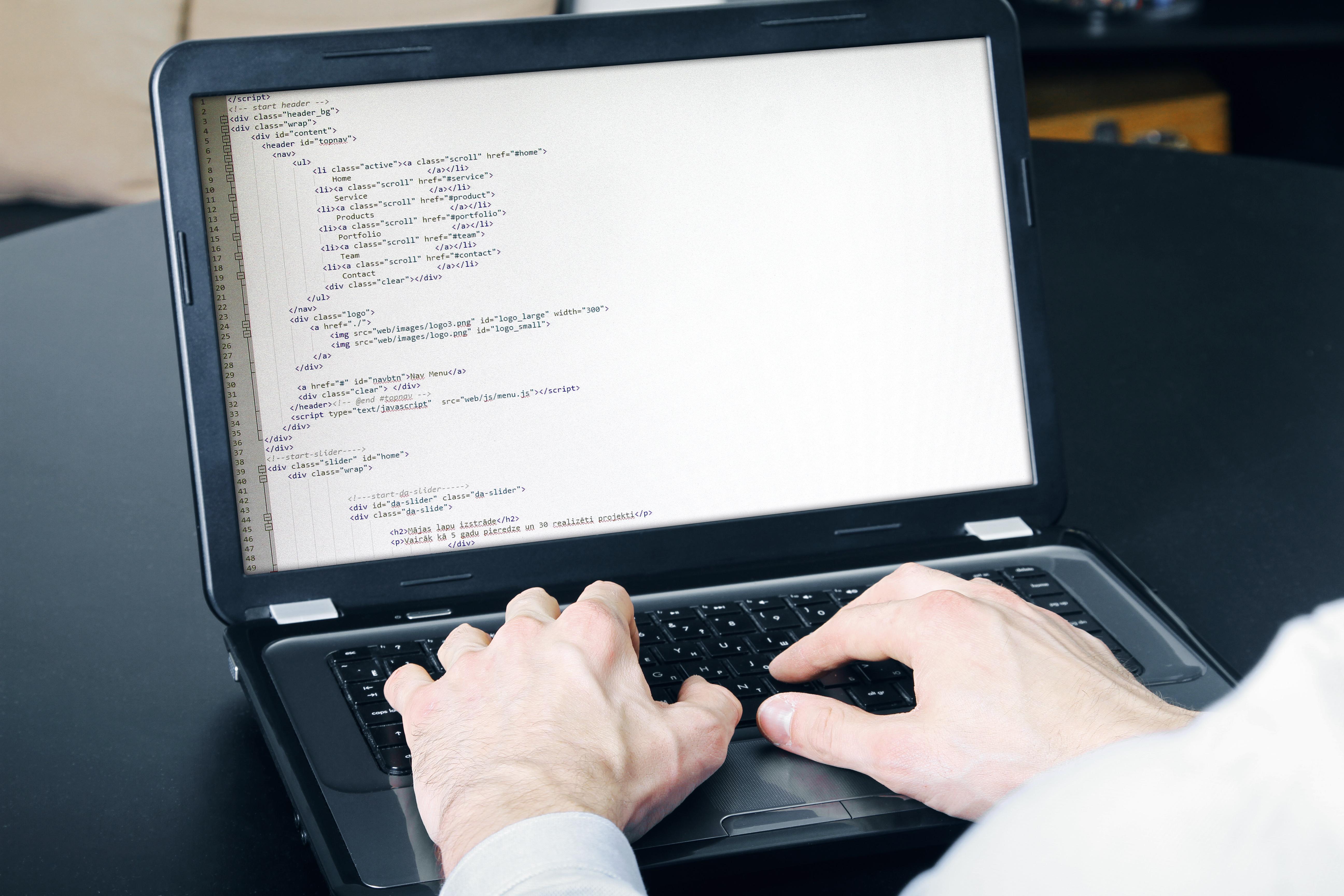website development process - programmer writing code